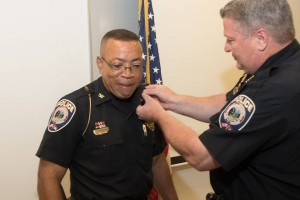 Submitted photo Pinehurst Police Chief Earl Phipps helps change the rank for newly installed Deputy Chief Ricky Gooch. Gooch becomes the first officer to rise through the ranks.