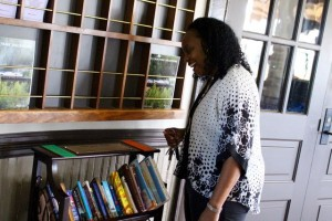 Kevin Spradlin | PeeDeePost.com Carmella Johnson, supervisor of the Hamlet Library, looks at the newly installed bookshelf with complimentary books situated inside the Hamlet Depot.