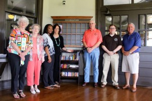 Kevin Spradlin | PeeDeePost.com Nana Winston, Jane McCall, Carmella Johnson, Linda Bayless, Bill Bayless, Marcus Abernethy and Jim Graham pose for a photo around the bookshelf inside the Hamlet Depot rotunda.
