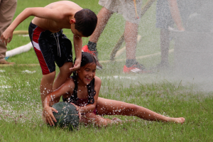Kevin Spradlin | PeeDeePost.com Elijah Tang, 10, and little sister Anna, 8, both of Troutman, wrestle for a watermelon.