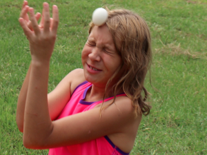 Kevin Spradlin | PeeDeePost.com Kelli Bass, 11, of Ellerbe, misses the throw from her brother Cameron, 7 — but the duo won the event by being the last group to drop their egg.