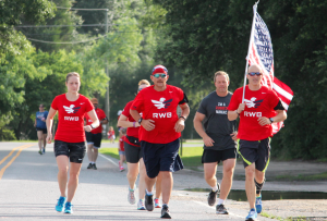 Kevin Spradlin | PeeDeePost.com The vanguard of the Team RWB Sandhills chapter at the start of the 4-mile run from Lewis Cannon Park in Pinehurst.