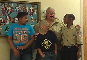 Submitted photo Webelos Osirid Rivera, Dwight Wallace and Elijah Jasper discuss their Webelos Overnight Adventure Camp with Cub Master Charleen Wallace in front of family, friends and honored guests before each received several belt loop and pin activity awards.