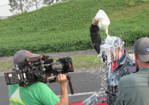 Submitted photo Mike Rowe drenches himself with a celebratory beverage after accelerating to 144 miles per hour at Rockingham Dragway.