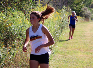 Kevin Spradlin | PeeDeePost.com Mountain Ridge senior Molly Offstein, left, eyes the turn that marks the crest of the final hill on Tuesday in the Mountain Ridge Cross Country Invitational at Glendening Park in Frostburg. Only a few seconds behind her is Allegany junior Kaylee Buckbee.