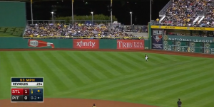 This screenshot from a Major League Baseball video of Mark Reynolds' two-run homer in the ninth inning shows, in the top right corner, me and my Cardinal red Team RWB hoodie — sitting in a sea of black and gold.