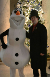 Mayor Brian Grim stands with Olaf from Disney's animated feature Frozen inside City Hall in Cumberland.