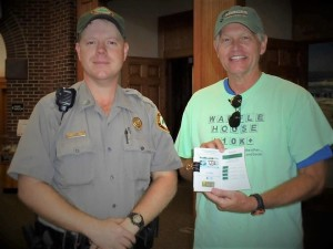 Photo courtesy Mark Long Park Ranger Paul Terry signed my passport booklet to validate 41 stamps for 41 state parks at Fort Macon State Park.