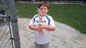 Courtesy photo Ashton Bates clutches a trophy earned while playing for the Summerfield Recreation Association baseball league.