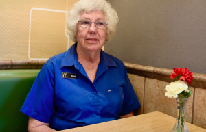 Kevin Spradlin | PiedmontPostNC.com Hilda Coleman was named McDonald's Crew Person of the Year for the Triad Co-Op for calendar year 2017. Coleman, 76, a native of Colfax who lives in Stokesdale, works at the Albert Pick Road store located off N.C. 68 in Greensboro. She is pictured by a vase of yellow and red flowers Coleman is responsible for maintaining each morning. The colors have personal meaning for Coleman.