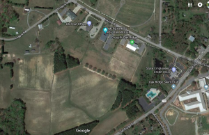 Google Maps image The 58-acre property, currently being farmed for hay, should come into Town of Oak Ridge ownership in July. The land is west of Oak Ridge Town Hall, sandwiched between Scoggins Road to the north and Oak Ridge Road to the south.