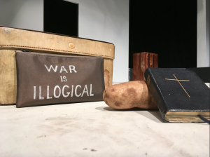 Photo by Kevin Spradlin | PiedmontPostNC.com On a minimalist set, playwright and actor Michael Mears used a Bible, a potato and a pencil case to help tell the story of conscientious objectors during World War I.
