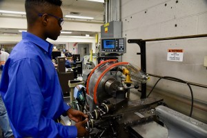 Kevin Spradlin | PiedmontPostNC.com Andrew Hairston, a senior at Northern Guilford High School, works a lathe machine at TE Connectivity in Greensboro. He goes to school for half a day and works a shift in the mold shop the rest of the day. Within five years, Hairston has a chance to earn his journeyman's card and an associate's degree – all paid for by TE Connectivity.